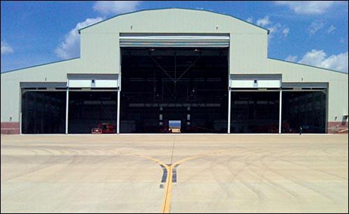 Airport Hangar - In-Panel Entry Doors & Cline Doors - Aluminum and FRP Door Project Gallery